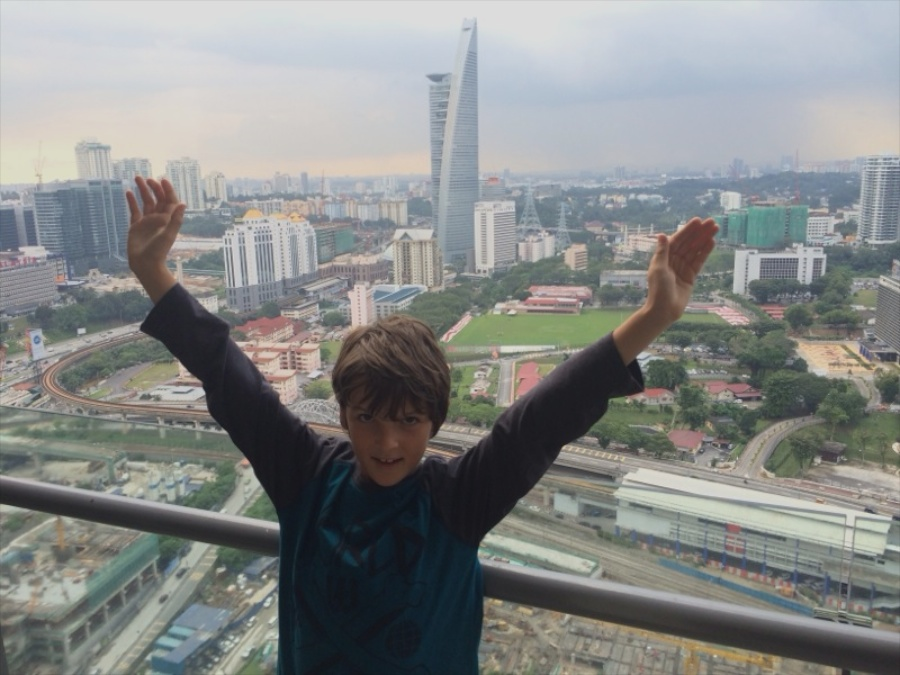 kai with stark tower behind him, on the balcony