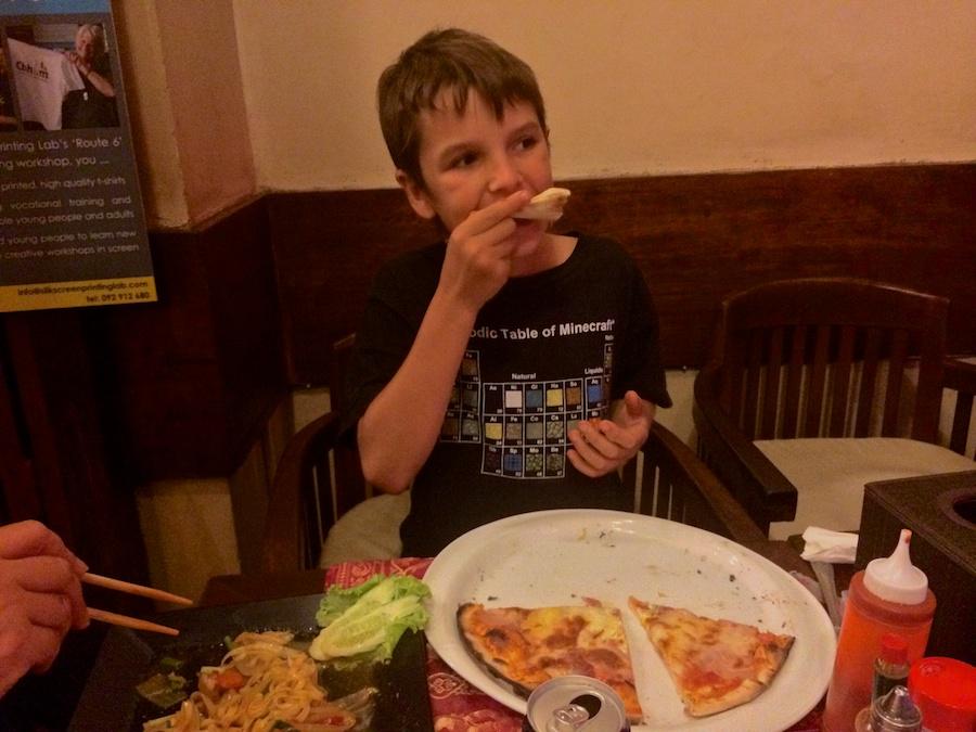 kai demolishing a surprisingly good pizza!