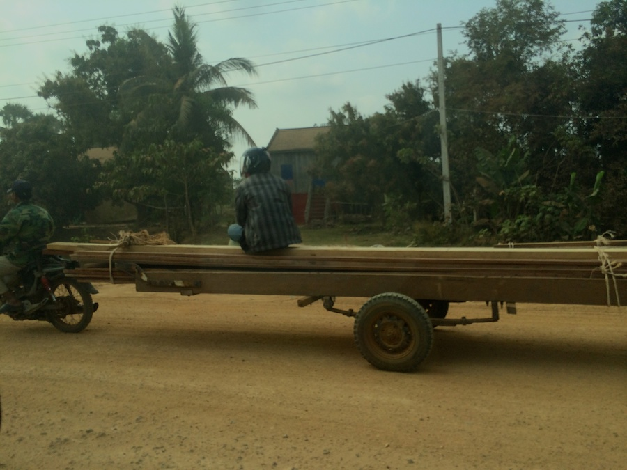 motorbike with 10m trailer of wood