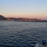 hills ablaze with pink light from sunset, knidos